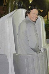 Fairfax columnist Charles Waterstreet tries out one a urinal in Sydney.