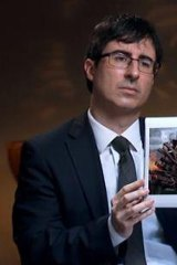 Comedian John Oliver has a regular spot on <i>The Daily Show</i>.