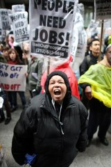 Angry mob... demonstrators rally against government cash bailouts in New York City's financial district on Friday.