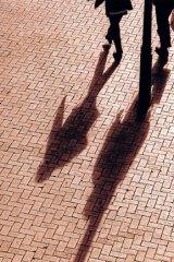 Long shadows hang over bank workers.