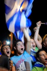 What currency crisis? ... Football fans in Athens savour Greece's victory over Russia in Euro 2012.