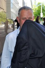 Former Catholic priest David Rapson leaves court.