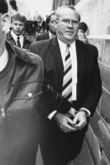 Jackson being led into court in 1987.