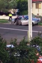 A police officer was allegedly dragged for 20m down a western Sydney street during an arrest on Friday.