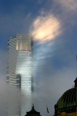 A hazy future? Fog and reflected sunlight around the Eureka Tower in Melbourne yesterday morning.