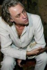 Live Aid: Bob Geldof talks to orphans in Ethiopia in  2003.