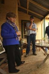 Green tea ... Milne addresses local farmers over some light refreshments.