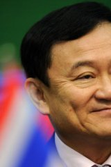 'We must strengthen democracy ... if democracy flourishes the military will have to stay in its camps,' Former Thai Prime Minister Thaksin Shinawatra.