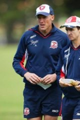 On the road to glory: Roosters assistant coaches Craig Fitzgibbon and Jason Taylor in 2013.