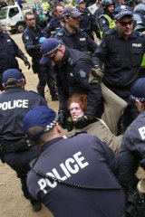 Police forcibly remove a protester.