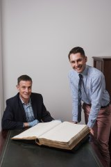 Martyn Killion, director, Collections, Access & Engagement and NSW State Archives' Executive Director Adam Lindsay with the 1828 Census from the State Archives Collection.  Mr Killion's great great grandmother Charlotte Mason is listed.