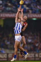 Dustin Fletcher spoils North's Robbie Tarrant.