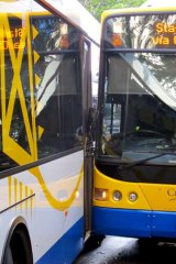Two buses sit on Adelaide Street after colliding.