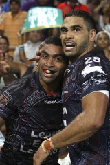 Joy ... Nathan Merritt with Greg Inglis.