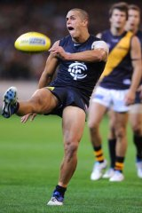 Ed Curnow gets a kick away for the Blues against Richmond.