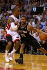 Canberra's Patty Mills, right.