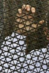 Australian journalist Peter Greste inside the defendants' cage during the trial. He was sentenced to seven years in jail on Monday.
