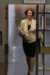 Prime Minister Julia Gillard — under fire on various fronts including a Melbourne house renovation and a union 'slush fund' — arrives at question time yesterday.