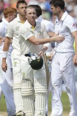 Brad Haddin pats England's James Anderson after England won the first Ashes Test.