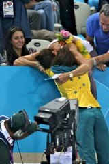 Mixed emotions ... Emily Seebohm is congratulated by family after winning a silver medal in the 100m backstroke.