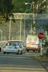 An ambulance leave Villawood Detention Centre.