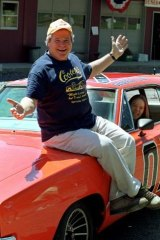 Ben 'Cooter' Jones with a hotrod used in shooting for the <i>Dukes of Hazzard</i> back in 1999.