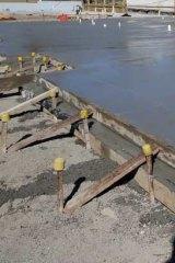 Builders prepare a slab.