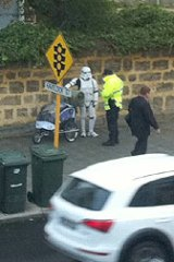 Spotted in West Perth - Jacob French dressed as a Storm Trooper receives a talking to from the Federal Police.