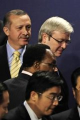 Kevin Rudd talks to Barack Obama at the G20 summit, London, 2009. Also pictured are, clockwise from top left, Turkey's Tayyip Erdogan, Britain's  Gordon Brown, China's Hu Jintao, an unidentified translator and South Africa's Kgalema Motlanthe.