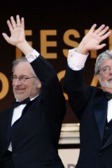"""US directors Steven Spielberg, left, and George Lucas sparked a debate by warning of an """"implosion"""" of the traditional movie industry."""