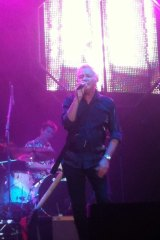 Iva Davies, Icehouse frontman, pops a button performing for the <i>Evening on the Green</i> crowd in Perth.