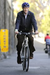 On your bike...Peter Garrett is peddling a more local message. Photo: Pat Scala.