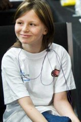 Zahra Baker, pictured a year ago while waiting for a hearing aid.