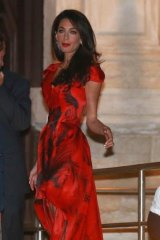 Amal Alamuddin arriving in Venice prior to her wedding to George Clooney wearing an Alexander McQueen gown.