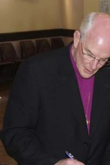 Attending ... the Bishop of Maitland and Newcastle Bill Wright.