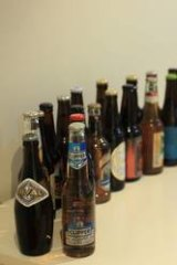Ellis and Maguire's beer bottle collection is growing.