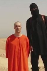 Kneeling in the sand: The footage, released on social media by Islamic State militants.