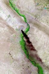 A satellite picture from the US Geological Survey dated June 18 shows smoke rising from the Baiji refinery near the Iraqi city of Tikrit, a focus of fighting between Sunni militants and government forces.