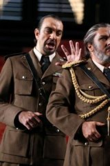 Simon O'Neill, right, in dark face make-up as Otello.