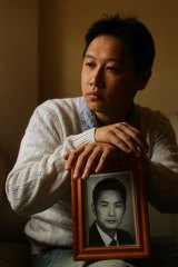 Appealing to the Prime Minister: Tommy Du with a photo of his father.