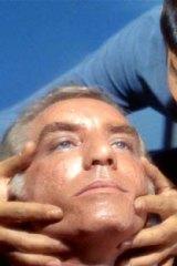 """Spock performs a """"mind meld"""" in <em>Star Trek</em>."""