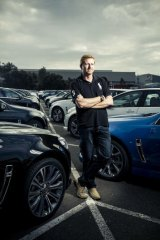 Rolling on … senior technical officer Steve Brecht in a car park full of new VF Commodores.