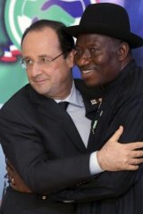 'Your struggle is our struggle'  ... French President Francois Hollande hugs Nigerian President Goodluck Jonathan (right) after they opened the Nigeria-France business forum in Abuja on Thursday.