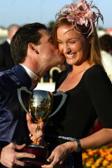 Danny Nikolic (left) with his former wife, Les Samba's daughter Victoria, after the jockey's victory in the Doomben Cup aboard Perlin in 2005.