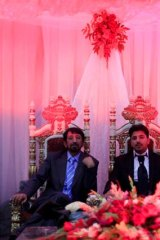 Ahmed Rashed Azimi sits on a throne next to his father at a male-only party. Women celebrated at a separate event.