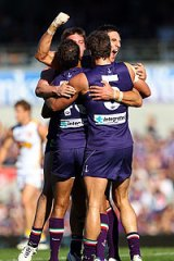 Matthew Pavlich celebrates a goal with his Dockers teammates.