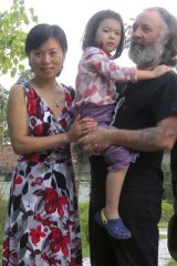 Another Aussie in trouble: Carl Mather with wife Xie Qun and daughter Doreen.