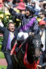 Damien Oliver returns to the scales on Fiorente after winning the 2013 Melbourne Cup.