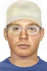 A police image of the wanted man.