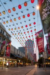 The festive spirit descends on the Bourke Street Mall.